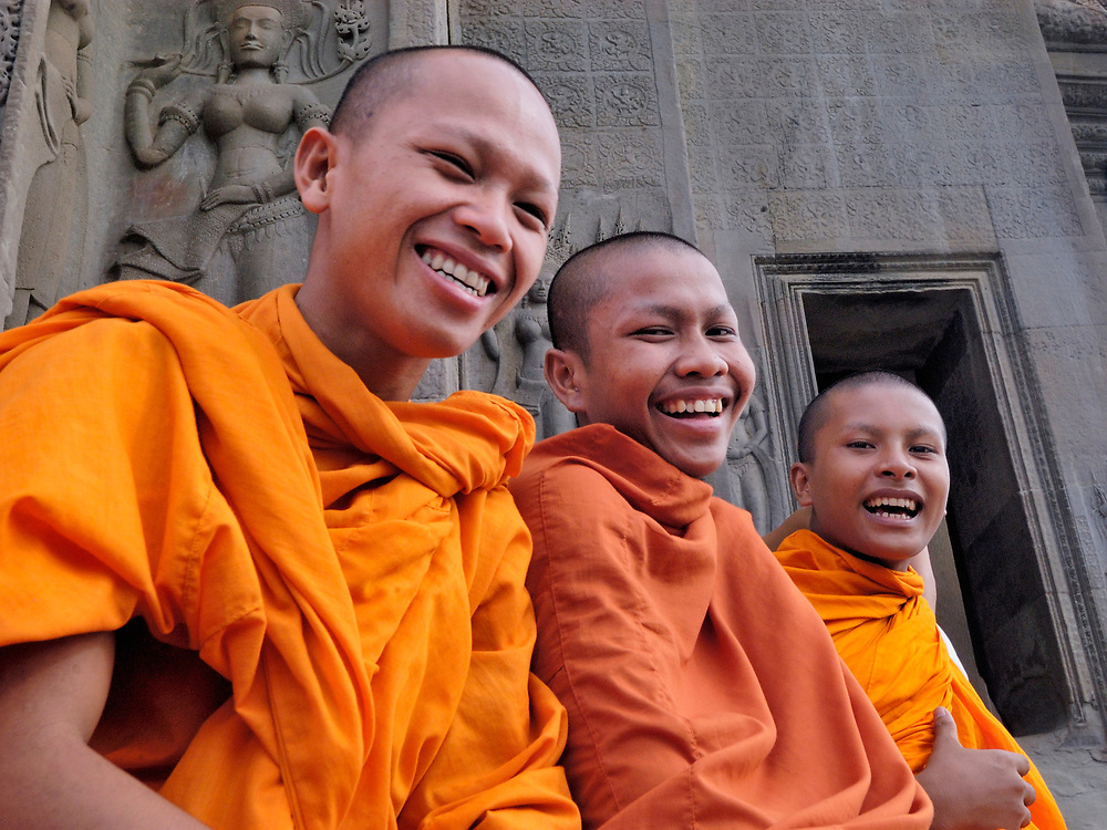 Buddhist monks in a temple in the Angkor Wat complex in Cambodia, which dates to the 12th Century.