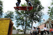 Saturday, August 2, 2008- Little Village youth practice their moves on the 3000 block of S. Albany Avenue before an upcoming skateboarding competition. The event is organized by community groups demanding more park space in the community, a scarce resource in the neighborhood that is crowded by businesses and industry. Their intent is to build on an adjacent empty plot of  land, formerly an industrial site.