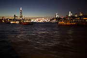 Skyline view of the City of London and the River Thames. London, UK. The view provides an impressive night cityscape from The Shard, Tower Bridge to the City of London.