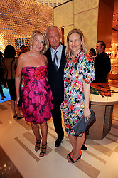 Left to right, GALEN & HILARY WESTON and their daughter ALANNAH at a party to celebrate the opening of the Louis Vuitton Bond Street Maison, New Bond Street, London on 25th May 2010.