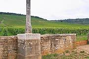 Vineyard. Base of the stone cross with inscription, erected 1723. Romanee Conti Grand Cru. Vosne Romanee, Cote de Nuits, d'Or, Burgundy, France
