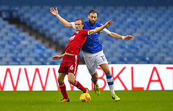 Birmingham City's Maikel Kieftenbeld (left) and Sheffield Wednesday's Atdhe Nuhiu battle for the ball