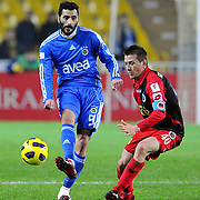 Fenerbahce's Daniel Gonzalez GUIZA (L) and Genclerbirligi's Cem CAN (R) during their Turkey Cup group c matchday 5 soccer match Fenerbahce between Genclerbirligi at the Sukru Saracaoglu stadium in Istanbul Turkey on Thursday 27 January 2011. Photo by TURKPIX