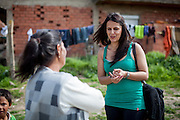 Romina Kajtazova - working as a paralegal for NGO Kham - talking during field work to Ljutvia Demyrova - a 29 years old mother of 8 children at the local Roma community during the European Immunization Week in the city of Vinica in Macedonia.