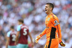Burnley goalkeeper and captain Tom Heaton shouts instructions to his teammates