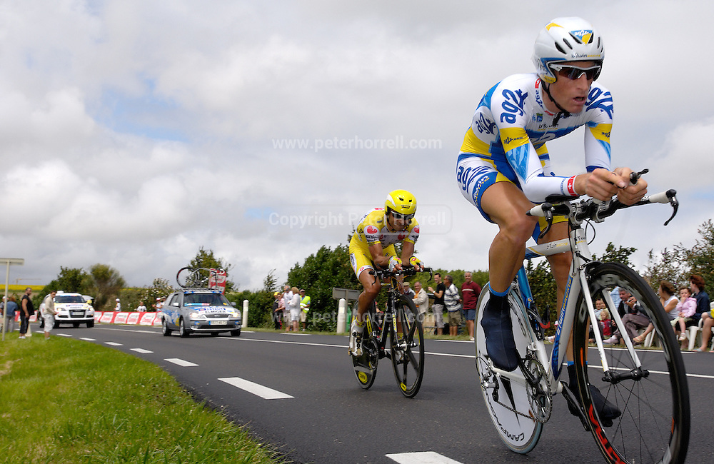 FRANCE, SATURDAY 28th JULY 2007:  Stage 19 Cognac - Angouleme, 55.5 km time trial. Martin Elmiger (AG2r Prévoyance) catches and overtakes Christophe Rinero (Saunier Duval - Prodir) with approximately 17km to go to the finish.
