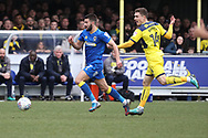 AFC Wimbledon defender George Francomb (7) taking on Oxford United midfielder Josh Ruffels (14) during the EFL Sky Bet League 1 match between AFC Wimbledon and Oxford United at the Cherry Red Records Stadium, Kingston, England on 10 March 2018. Picture by Matthew Redman.