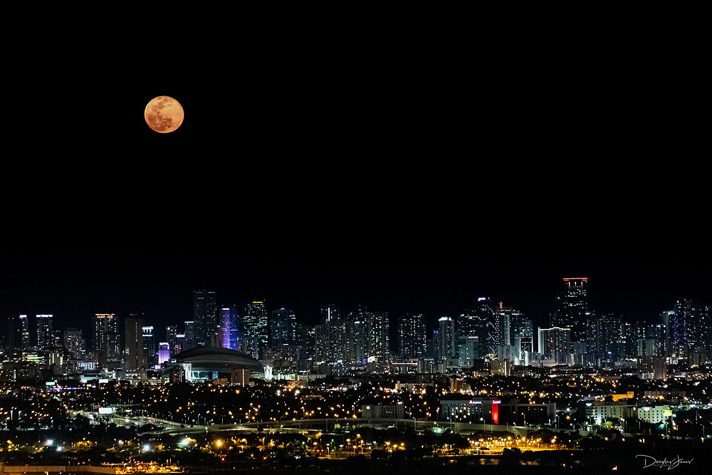 APR 8, 2020; Miami, FL USA; Images of the Super Pink Moon from the catwalk of the Miami International Airport (MIA) control tower.