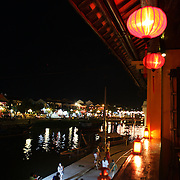 A street scene in Hoi An, Vietnam showing coloured lanterns at night time. Hoi An is an ancient town and an exceptionally well-preserved example of a South-East Asian trading port dating from the 15th century. Hoi An is now a major tourist attraction because of its history. Hoi An, Vietnam. 5th March 2012. Photo Tim Clayton