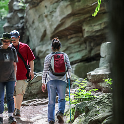 Benton, PA, USA - June 15, 2013: Hikers on one of the 26 miles of trails in Pennsylvania's Ricketts Glen State Park.