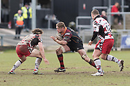 Lewis Evans of the Newport Gwent Dragons takes on Hamish Watson of Edinburgh as John Andress (R) of Edinburgh rugby closes in. Guinness Pro12 rugby match, Newport Gwent Dragons v Edinburgh Rugby at Rodney Parade in Newport, South Wales on Sunday 27th March 2016.<br /> pic by  Simon Latham, Andrew Orchard sports photography.