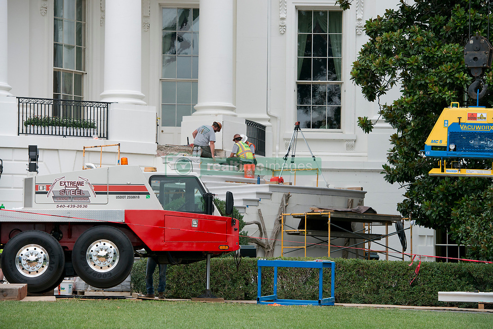 The White House West Wing in Washington, DC is undergoing renovations while United States President Donald J. Trump is vacationing in Bedminster, New Jersey on Friday, August 11, 2017. 11 Aug 2017 Pictured: Stone masons work on the steps of the South Portico of the White House in Washington, DC as it is undergoing renovations while United States President Donald J. Trump is vacationing in Bedminster, New Jersey on Friday, August 11, 2017. Credit: Ron Sachs / CNP. Photo credit: Ron Sachs - CNP / MEGA TheMegaAgency.com +1 888 505 6342