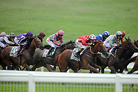 Horse Racing - 2021 Epsom Festival - The  Oaks Friday - Epsom Downs <br /> <br /> Winner, Snowfall (Frankie Dettori) (Purple cap - left ) comes from the back of the field at Tattenham corner<br /> <br /> <br /> Credit : COLORSPORT/ANDREW COWIE