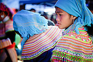 Vietnam, Bac Ha. Flower Hmongs women at the Sunday market in Bac Ha.