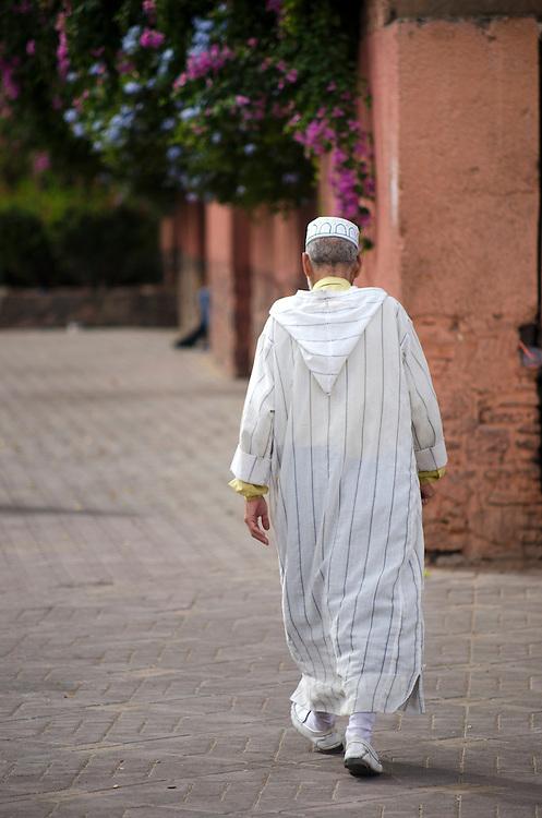Local man walks along Jemaa el Fna Marrakech Morocco