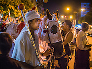 04 NOVEMBER 2014 - YANGON, MYANMAR: A Burmese Shia dressed as a bodyguard for Hussein ibn Ali waits with a horse to start an Ashura procession the Mogul Mosque (Masjid) in Yangon during Ashura services. Ashura commemorates the death of Hussein ibn Ali, the grandson of the Prophet Muhammed, in the 7th century. Hussein ibn Ali is considered by Shia Muslims to be the third imam and the rightful successor of Muhammed. He was killed at the Battle of Karbala in 610 CE on the 10th day of Muharram, the first month of the Islamic calendar. According to Myanmar government statistics, only about 4% of the population is Muslim. Many Muslims have fled Myanmar in recent years because of violence directed against Burmese Muslims by Buddhist nationalists.    PHOTO BY JACK KURTZ