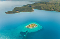 Aerial view of small islet of Itea called Agios Konstatinos in Greece