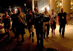 10 Sept 2005.  New Orleans, Louisiana.  Hurricane Katrina aftermath. <br /> Journalists walk back to the Best Western after curfew in the city.<br /> Photo; ©Charlie Varley/varleypix.com