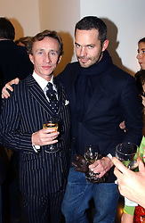 Left to right, JASPER CONRAN and TYLER BRULE at an exhibition of photographs by Matthew Mellon entitled Famous Feet - featuring well known people wearing shoes from Harrys of London, held at Hamiltons Gallery, Carlos Place, London on 22nd November 2004.<br /><br />NON EXCLUSIVE - WORLD RIGHTS