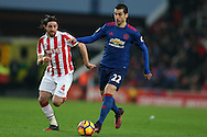 Henrikh Mkhitaryan of Manchester Utd ® goes past Joe Allen of Stoke city. Premier league match, Stoke City v Manchester Utd at the Bet365 Stadium in Stoke on Trent, Staffs on Saturday 21st January 2017.<br /> pic by Andrew Orchard, Andrew Orchard sports photography.