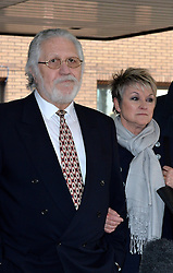 Dave Lee Travis speaks to press outside of Southwark Crown Court after being found not guilty of all but two charges. Pictured right is Marianne Griffin (wife).<br />  Thursday, 13th February 2014. Picture by Ben Stevens / i-Images
