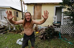 August 27, 2017 - Port Aransas, Texas, U.S. - Port Aransas resident JOE FOWLER holds his hands up to illustrate how he held up wooden boards to brace against the door of his home to keep wind and water from entering in the aftermath of Hurricane Harvey. Fowler was amongst a group of residents who opted to ride out the storm instead of evacuating. (Credit Image: © Kin Man Hui/San Antonio Express-News via ZUMA Wire)