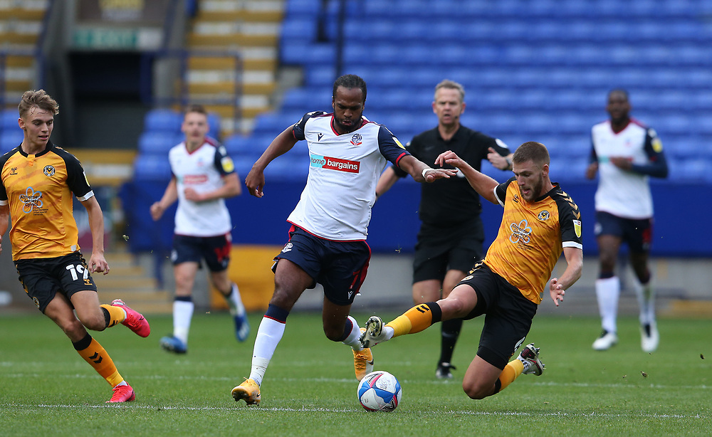Bolton Wanderers' Nathan Delfouneso is tackled by Newport County's Brandon Cooper<br /> <br /> Photographer Stephen White/CameraSport<br /> <br /> The EFL Sky Bet League Two - Bolton Wanderers v Newport County - Saturday 26th September 2020 - University of Bolton Stadium - Bolton<br /> <br /> World Copyright © 2020 CameraSport. All rights reserved. 43 Linden Ave. Countesthorpe. Leicester. England. LE8 5PG - Tel: +44 (0) 116 277 4147 - admin@camerasport.com - www.camerasport.com
