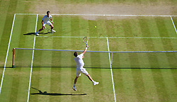 04.07.2014, All England Lawn Tennis Club, London, ENG, ATP Tour, Wimbledon, im Bild Novak Djokovic (SRB) looks on helpless as Grigor Dimitrov (BUL) smashes a winning point during the Gentlemen's Singles Semi-Final match on day eleven // during the Wimbledon Championships at the All England Lawn Tennis Club in London, Great Britain on 2014/07/04. EXPA Pictures © 2014, PhotoCredit: EXPA/ Propagandaphoto/ David Rawcliffe<br /> <br /> *****ATTENTION - OUT of ENG, GBR*****