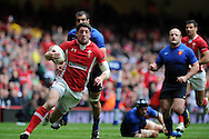 Alex Cuthbert of Wales runs in to score the opening try.  RBS Six nations championship 2012, Wales v France at the Millennium Stadium in Cardiff, South Wales on Saturday 17th March 2012.  pic by Andrew Orchard, Andrew Orchard sports photography,