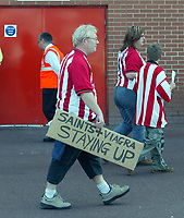Photo. Chris Ratcliffe, Digitalsport<br /> Southampton v Manchester United. Barclays Premiership. 15/05/2005<br /> A fan leaves the ground with his placard which was so wrong