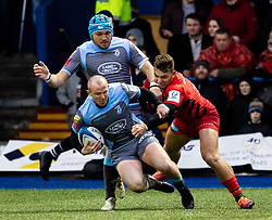 Dan Fish of Cardiff Blues under pressure from Alex Lewington of Saracens<br /> <br /> Photographer Simon King/Replay Images<br /> <br /> European Rugby Champions Cup Round 4 - Cardiff Blues v Saracens - Saturday 15th December 2018 - Cardiff Arms Park - Cardiff<br /> <br /> World Copyright © Replay Images . All rights reserved. info@replayimages.co.uk - http://replayimages.co.uk