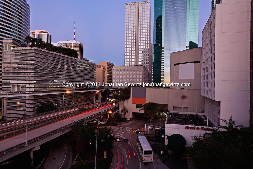 Twilight view of Miami's downtown commercial and hotel district, expressway ramps to US Route 95 and Metromover elevated rail tracks. WATERMARKS WILL NOT APPEAR ON PRINTS OR LICENSED IMAGES.
