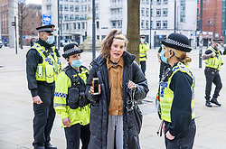 © Licensed to London News Pictures. 07/03/2021. Manchester, UK. Police break up what they say is an illegal gathering under Coronavirus legislation as nurses and their supporters attempt to protest in St Peter's Square in Manchester City Centre over the British Government proposing a one percent pay increase to nurses' salaries . Photo credit: Joel Goodman/LNP