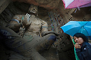 Tourists visiting Yungang Budha Caves in Datong. The caves are ancient budhist temple grottoes and were made Unesco World Heritage Site in 2001.