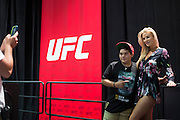 LAS VEGAS, NV - JULY 9:  Kristie Pearson poses for a photo with a young fan during the UFC Fan Expo at the Las Vegas Convention Center on July 9, 2016 in Las Vegas, Nevada. (Photo by Cooper Neill/Zuffa LLC/Zuffa LLC via Getty Images) *** Local Caption *** Kristie Pearson