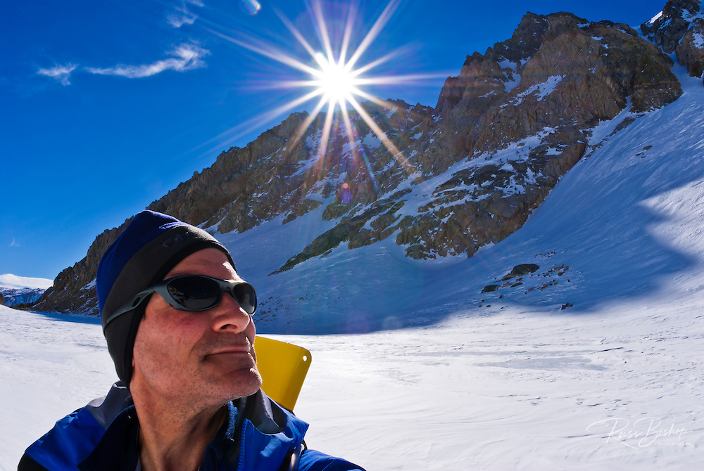 Sunflair over backcountry skier, Inyo National Forest, Sierra Nevada Mountains, California