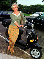 TV presenter MARIELLA FROSTRUP and her scooter, at an exhibition in London on 13th September 1999.MWG 26