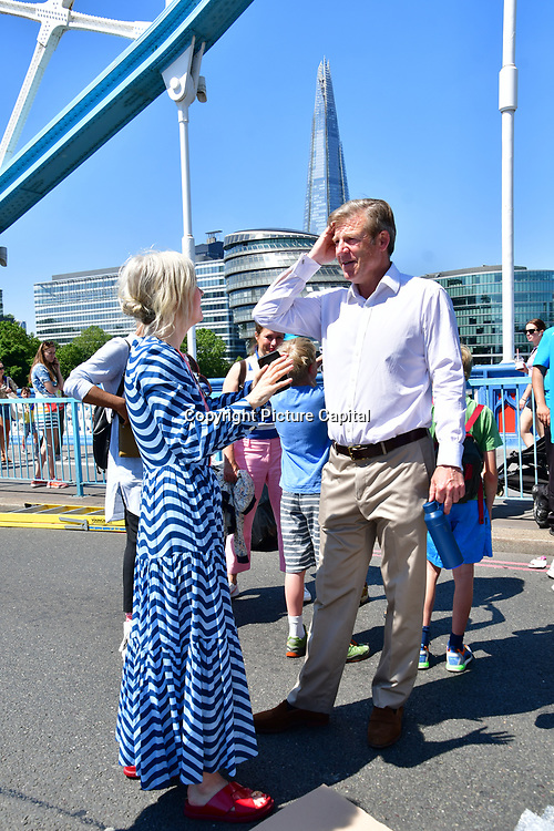 William Russell is the Lord Mayor of the City of London, Justine Simons attend to celebrates London hosting of UEFA EURO 2020 including both semi finals and the final with thousands of poster laid along Tower Bridge on 13th June 2021, London, UK