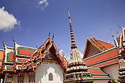 09 MARCH 2009 -- BANGKOK, THALAND: The roofline of Wat Po in Bangkok, Thailand. Wat Phra Chetuphon is more commonly known by its old name of Wat Po. The temple is much older than the city of Bangkok itself. It was founded in the 17th century, making it the oldest temple in Bangkok. The name Wat Po comes from its original name of Wat Potaram. King Rama I, the founder of Bangkok, enlarged the temple, installed many statues and other artefacts recovered from Ayuthaya, and renamed the temple Wat Phra Chetuphon in 1801. Rama III enlarged the temple in 1832 and turned the temple into a center of learning, making it in essence Thailand's first university. Rama III is also responsible for the construction of the reclining Buddha, which the temple is famous for.  Photo By Jack Kurtz