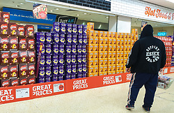 © Licensed to London News Pictures. 08/04/2020. London, UK. A man looks at a wide range of Easter Eggs at Sainsbury's supermarket in north London. The supermarket has lifted restrictions on Easter Eggs during COVID 19 outbreak. Photo credit: Dinendra Haria/LNP