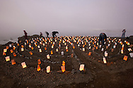 Volunteers light luminaries at the Lands End Labyrinth overlooking the Golden Gate Bridge - San Francisco, California