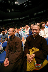 18 May 2013. New Orleans, Louisiana,  USA..Buddhist monks listen intently to His Holiness the 14th Dalai Lama at the University of New Orleans Lakefront Arena for the 'Resiliance - Strength through Compassion and Connection' conference. .Photo; Charlie Varley.