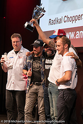 Samuele Reali of Abnormal Cycles Italy won 7th place in the big Freestyle Class in the AMD World Championship of Custom Bike Building awards ceremony in the Intermot Customized hall during the Intermot International Motorcycle Fair. Cologne, Germany. Sunday October 7, 2018. Photography ©2018 Michael Lichter.