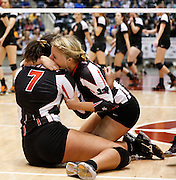 Lovejoy's Ebony Nwanebu (7) and Katelyn McKenzie (11) embrace each other after beating Aledo in the Class 4A state championship at the Curtis Culwell Center in Garland, Texas, on November 17, 2012.  (Stan Olszewski/The Dallas Morning News)
