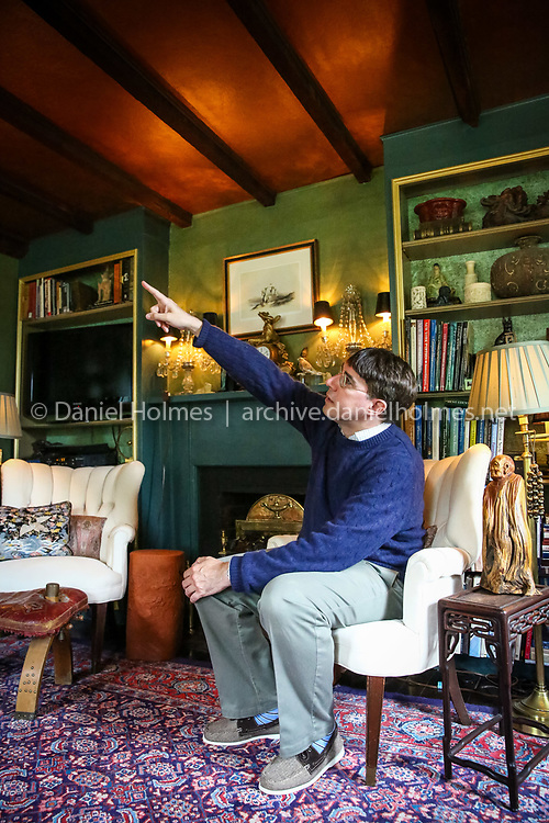(6/14/14, FRAMINGHAM, MA) Jeff Delvy points out some of the old beams in the ceiling of his antique home (c. 1730) on Grove Street in Framingham on Saturday. Daily News and Wicked Local Photo/Dan Holmes