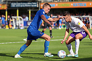 AFC Wimbledon attacker Marcus Forss (15) taking on Shrewsbury Town midfielder Ryan Giles (11) during the EFL Sky Bet League 1 match between AFC Wimbledon and Shrewsbury Town at the Cherry Red Records Stadium, Kingston, England on 14 September 2019.