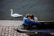 "Couple kissing on the ""Moldau"" riverside in Prague."