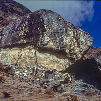 A shrine under a boulder is believed to be a place where the Tibetan Buddhist saint Padma Sambhava once meditated in the remote Hinku Valley, just east of the Khumbu region of Nepal's Himalaya.