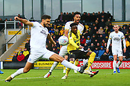 Burton Albion forward Devante Cole (44) is surrounded by Peterborough players during the EFL Sky Bet League 1 match between Burton Albion and Peterborough United at the Pirelli Stadium, Burton upon Trent, England on 27 October 2018.