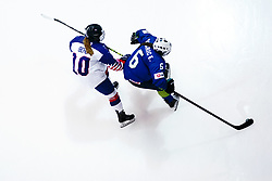 Great Britain's Lucy Beal (left) and Slovenia's Eva Dukaric battle for the puck during the Beijing 2022 Olympics Women's Pre-Qualification Round Two Group F match at the Motorpoint Arena, Nottingham.